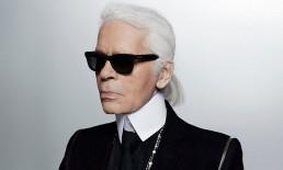 Karl Lagerfeld con gli immancabili occhiali da sole molto scuri